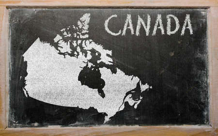 drawing of canada on blackboard, drawn by chalk Stock Photo - 12500339