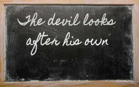 handwriting blackboard writings - The devil looks after his own