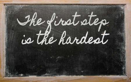 handwriting blackboard writings - The first step is the hardest Фото со стока