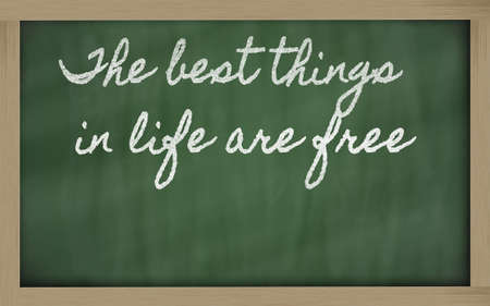 handwriting blackboard writings - The best things in life are free Stock Photo - 12498921