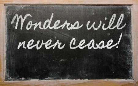 cease: handwriting blackboard writings - Wonders will never cease! Stock Photo