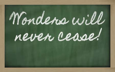 handwriting blackboard writings - Wonders will never cease! Фото со стока