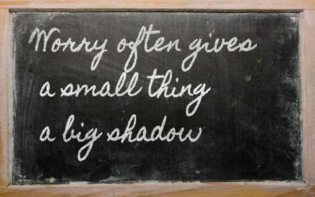 handwriting blackboard writings - Worry often gives a small thing a big shadow