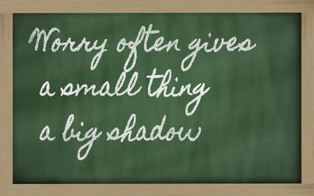 handwriting blackboard writings - Worry often gives a small thing a big shadow photo