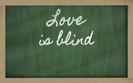 handwriting blackboard writings - Love is blind Фото со стока