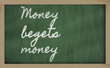 prudent: handwriting blackboard writings - Money begets money Stock Photo