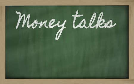 conversa: escritos de escritura a mano pizarra - Money Talks Foto de archivo