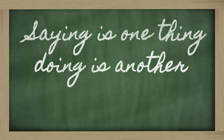 handwriting blackboard writings - Saying is one thing, doing is another