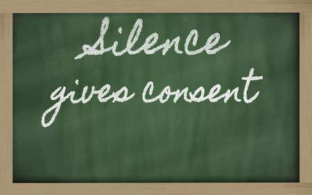 handwriting blackboard writings - Silence gives consent Stok Fotoğraf
