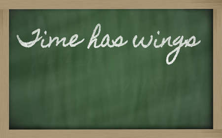 has: handwriting blackboard writings - Time has wings Stock Photo