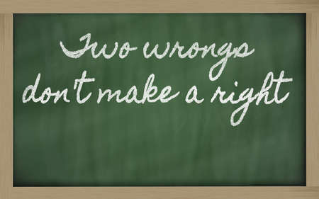 handwriting blackboard writings - Two wrongs don't make a right Stock fotó