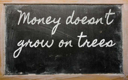 grow money: handwriting blackboard writings - Money doesnt grow on trees