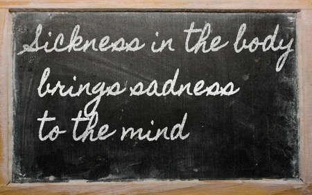 brings: scritti lavagna scrittura a mano - malattia nel corpo porta tristezza alla mente Archivio Fotografico