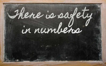handwriting blackboard writings - There is safety in numbers Stock Photo - 12501429