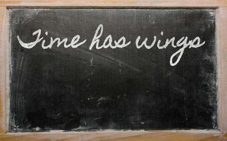 has: handwriting blackboard writings - Time has wings Stock Photo