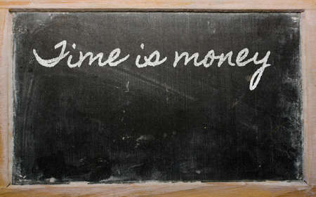 handwriting blackboard writings - Time is money Stock Photo - 12501420