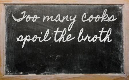 spoil: handwriting blackboard writings - too many cooks spoil the broth Stock Photo