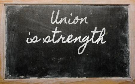 la union hace la fuerza: escritos de escritura a mano pizarra - Uni�n hace la fuerza Foto de archivo