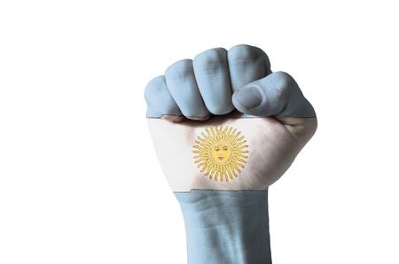 argentina flag: Low key picture of a fist painted in colors of argentina flag Stock Photo