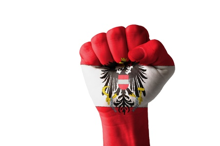 Low key picture of a fist painted in colors of austria flag photo