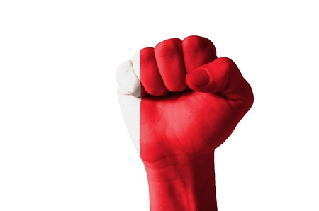 aggressor: Low key picture of a fist painted in colors of bahrain flag Stock Photo