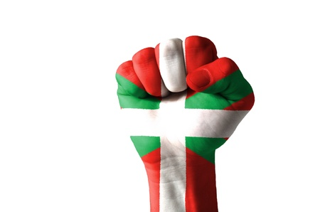 aggressor: Low key picture of a fist painted in colors of basque flag