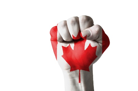 canada flag: Low key picture of a fist painted in colors of canada flag Stock Photo