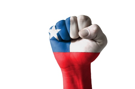 Low key picture of a fist painted in colors of chile flag Stock Photo