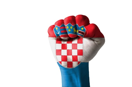 Low key picture of a fist painted in colors of croatia flag photo