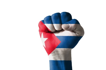 Low key picture of a fist painted in colors of cuba flag Stock Photo - 12981884