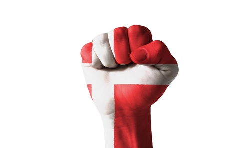 Low key picture of a fist painted in colors of denmark flag Stock Photo
