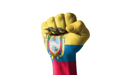 Low key picture of a fist painted in colors of ecuador flag Stock Photo - 12972303