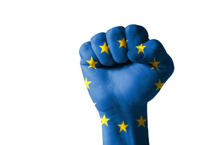 Low key picture of a fist painted in colors of europe flag photo