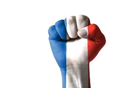 Low key picture of a fist painted in colors of france flag Stock Photo - 12981822