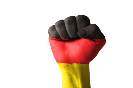 Low key picture of a fist painted in colors of germany flag photo