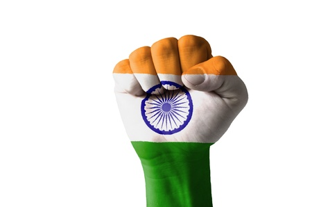 Low key picture of a fist painted in colors of india flag photo