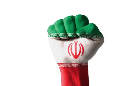 Low key picture of a fist painted in colors of iran flag photo