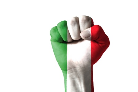 Low key picture of a fist painted in colors of italy flag