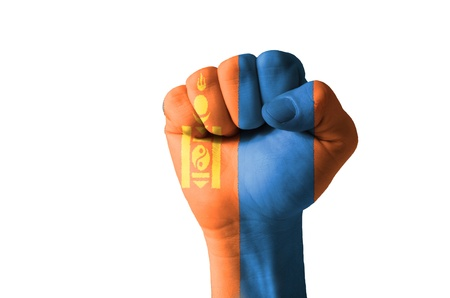 Low key picture of a fist painted in colors of mongolia flag photo