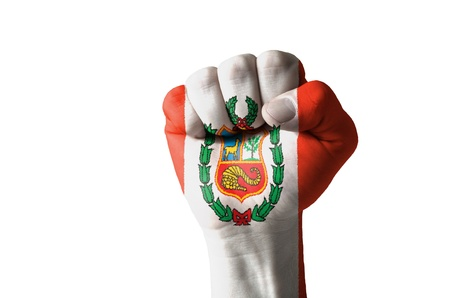 aggressor: Low key picture of a fist painted in colors of peru flag