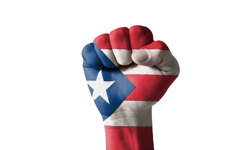 Low key picture of a fist painted in colors of puertorico flag Standard-Bild