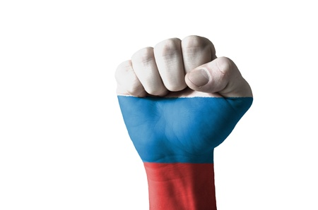 Low key picture of a fist painted in colors of russia flag photo