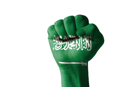 Low key picture of a fist painted in colors of saudi arabia flag photo