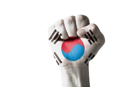 Low key picture of a fist painted in colors of south korea flag Stock Photo - 12981789