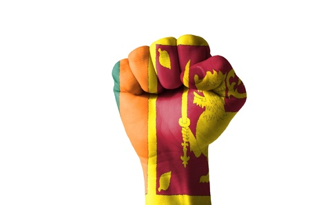 sri lankan flag: Low key picture of a fist painted in colors of srilanka flag Editorial