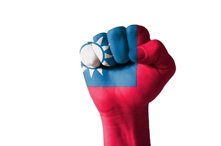 aggressor: Low key picture of a fist painted in colors of taiwan flag Stock Photo