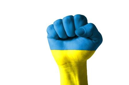 Low key picture of a fist painted in colors of ukraine flag photo