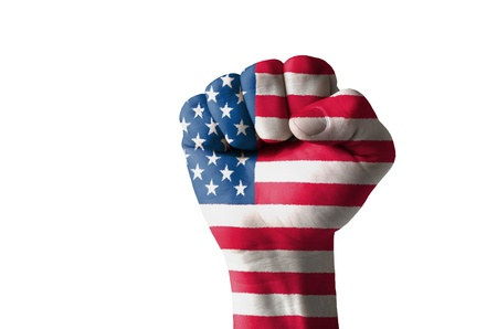 Low key picture of a fist painted in colors of american flag