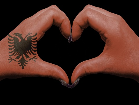 Gesture made by albania flag colored hands showing symbol of heart and love Stock Photo - 12981826