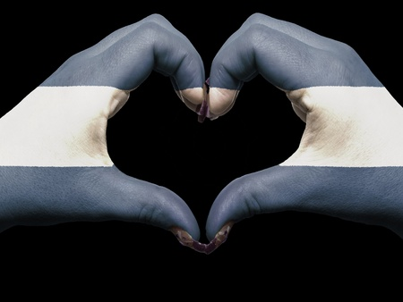 el salvador: Gesture made by el salvador flag colored hands showing symbol of heart and love